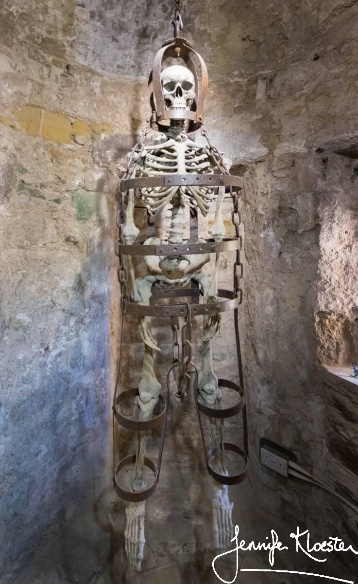 gibbet with skeleton in ypres tower cell rye castle